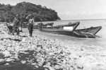 Two wrecked Japanese Daihatsu-class landing craft at Scarlet Beach, Finschhafen, New Guinea, 17 Oct 1943, photo 1 of 2