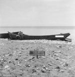 Two wrecked Japanese Daihatsu-class landing craft at Scarlet Beach, Finschhafen, New Guinea, 17 Oct 1943, photo 2 of 2