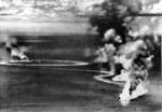 British cruisers Dorsetshire and Cornwall burning during the Indian Ocean Raid, 5 Apr 1942; photo taken from a Japanese aircraft