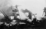 Cruiser Dupleix aflame at Toulon, France, circa 27 Nov 1942