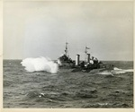 HMS Edinburgh underway in the Atlantic Ocean while escorting USS Wasp, 3 Apr 1942; side 1 of photo