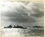 HMS Edinburgh and an American destroyer underway in the Atlantic Ocean while escorting USS Wasp, circa 3 Apr 1942; side 1 of photo