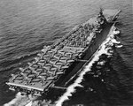 24 SBD, 11 F6F, and 18 TBF/TBM aircraft parked on the flight deck of carrier Essex, May 1943