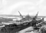 USS Essex undergoing modernization at drydock no. 5 of Puget Sound Naval Shipyard, Bremerton, Washington, United States, 22 Apr 1949; seen in US Navy Naval Aviation News Aug 1949