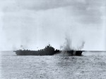 USS Essex under Japanese attack, off Japan, 19 Mar 1945