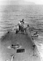 Crew of USS Finback pulling downed airman Lieutenant (jg) George Bush from the water off Chichi Jima, Bonin Islands, 2 Sep 1944