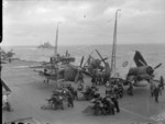 Barracuda and Corsair aircraft aboard HMS Formidable in the Norwegian Sea, Aug 1944; note HMS Berwick in background