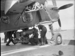 Armourers loading a 1,600-lb bomb onto a Barracuda aircraft aboard HMS Formidable, 1940s