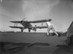 Flight deck signal officer directing the landing of an Albacore aircraft of No. 820 Squadron FAA aboard HMS Formidable, 1940s