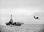 Albacore aircraft of No. 820 Squadron FAA having just taken off from HMS Formidable in the Indian Ocean, 29 May 1942; photo taken from HMS Warspite