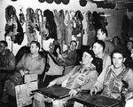 Pilots of US Navy Torpedo Squadron 13 in their ready room aboard carrier Franklin just before the Battle of the Sibuyan Sea, 24 Oct 1944; squadron command Lieutenant Commander Larry French seen second