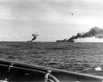 Carriers Belleau Wood and Franklin afire after being hit by suicide aircraft, off Samar, Philippine Islands, 30 Oct 1944