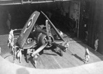 Corsair fighter in an elevator aboard HMS Glory, off Rabaul, New Britain, 6 Sep 1945, photo 1 of 2