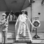 Vice Admiral Guy Russell leaving HMS Glory, Kure, Japan, circa 29 Sep 1951