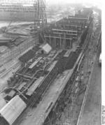 German carrier hull Flugzeugträger A (future Graf Zeppelin) under construction, Kiel, Germany, 22 Mar 1937, photo 1 of 9