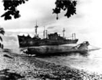 Japanese Type A Ko-hyoteki midget submarine and transport Yamazuki Maru beached on Guadalcanal, Solomon Islands, 1 May 1944