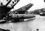 US Navy salvaging a Japanese Type A Ko-hyoteki midget submarine from shallows around Okinawa, Japan, 1945