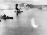 USAAF 3rd Bomb Group aircraft attacking Haguro and other ships in Simpson Harbor, Rabaul, New Britain, 2 Nov 1943, photo 2 of 2