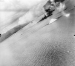 USAAF 3rd Bomb Group aircraft attacking Haguro and other ships in Simpson Harbor, Rabaul, New Britain, 2 Nov 1943, photo 1 of 2