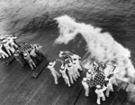Burial at sea aboard USS Hancock for those killed by Japanese special attack two days prior, off Okinawa, Japan, 9 Apr 1945