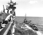 USS Bainbridge refueling from USS Hancock in the Atlantic Ocean, 14 Jun 1944