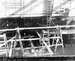 USS Helena in drydock at Pearl Harbor Navy Yard, US Territory of Hawaii, 13 Dec 1941, photo 2 of 2; note torpedo damage between frames 69 1/2 and 80 1/2 on starboard side