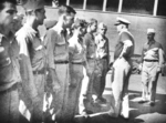 Admiral Walden Ainsworth meeting Captain Charles Carpenter (right) and survivors of USS Helena, 7 Jul 1943
