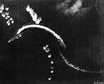 Hiryu maneuvering to avoid three sticks of bombs dropped by B-17 bombers, off Midway Atoll, shortly after 0800 hours, 4 Jun 1942, photo 1 of 2