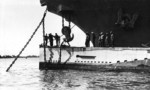 USS Holland preparing to hoist USS S-4 by the bow in preparation for repair work, 1920s