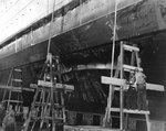 Cruiser Honolulu drydocked for damage suffered during Pearl Harbor attack, Pearl Harbor Navy Yard, 13 Dec 1941, photo 1 of 2