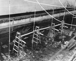 Cruiser Honolulu drydocked for damage suffered during Pearl Harbor attack, Pearl Harbor Navy Yard, 13 Dec 1941, photo 2 of 2