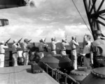 US Marines aboard USS Honolulu firing a salute during funeral services for a casualty from sunken USS Helena, circa 6 Jul 1943