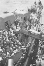 Survivors of USS Helena being transferred from destroyer USS Nicholas to cruiser USS Honolulu, Tulagi, Solomon Islands, 7 Jul 1943, photo 1 of 3