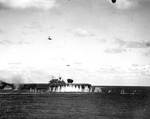 Japanese pilot Shigeyuki Sato in a D3A dive bomber plunging toward USS Hornet during Battle of the Santa Cruz Islands, 26 Oct 1942; note B5N torpedo bomber in level flight and splash from anti-aircraft shell burst in front of Hornet