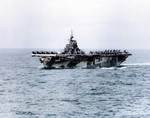 USS Hornet off Okinawa, Japan, 27 Mar 1945; note various aircraft on the flight deck