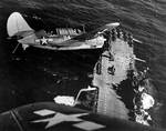 Helldiver aircraft over Hornet, South China Sea, mid-Jan 1945, photo 1 of 2