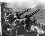 Gunnery practice with 40-mm Bofors MK 12 anti-aircraft guns aboard Hornet while her aircraft raided Japan, 16 Feb 1945