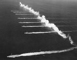 US Navy Destroyer Squadron 20 laying a smoke screen off San Diego, California, United States, 14 Sep 1936; note destroyers Farragut, Dewey, Hull, Macdonough, Worden, Dale, Monaghan, and Aylwin