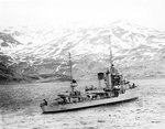 Hull approaching an anchorage in the lower end of Iliuliuk Bay, in the Aleutian Islands, North Pacific, 27 Apr 1937