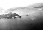 Hyuga sunken in shallow water, near Kure, Japan, 28 Jul 1945; photo taken by USS Shangri-La aircraft