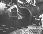 US Navy personnel inspecting the hangar of Japanese submarine I-400, circa late 1945 or early 1946