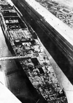 Incomplete light carrier Ibuki being taken apart at Sasebo, Japan, 14 Mar 1947