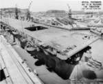 Carrier Independence under overhaul at Mare Island Naval Shipyard, California, United States, 11 Jul 1943; note hulls of submarines Spadefish and Trepang nearby