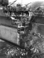 Battleship Washington in drydock at Pearl Harbor Navy Yard to repair collision damage sustained from battleship Indiana in the previous month, US Territory of Hawaii, Mar 1944