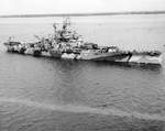 USS Indiana off Norfolk, Virginia, United States, 8 Sep 1942, photo 5 of 5; note crews completing the paint job of the hull