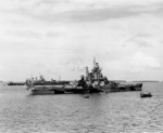 Battleship Indiana at Majuro, Marshall Islands for repairs after collison with battleship Washington, 3 Feb 1944; note Washington and AR-4 Vestal in background