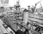 Indianapolis at Mare Island Navy Yard, California, view of port side of forward half, with light cruiser Raleigh in background, 19 Apr 1942