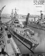 Indianapolis at Mare Island Navy Yard, California, view of her bow from starboard side, with heavy cruiser Minneapolis in background, 1 May 1943