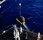 Gemini 3 spacecraft being hoisted aboard USS Intrepid during recovery, in the Atlantic Ocean north of the Dominican Republic, 23 Mar 1965, photo 1 of 2
