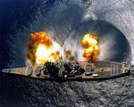 USS Iowa firing a full broadside during practice off Vieques island, Puerto Rico, 1 Jul 1984